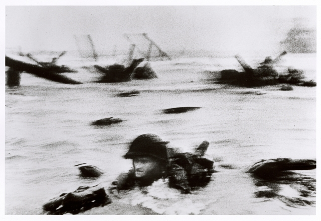 Robert Capa - American soldiers landing on Omaha Beach, D-Day, Normandy, France June 6, 1944 © Cornell Capa/Magnum International Center of Photography