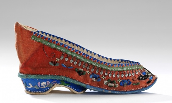 A 19th-century 'Lotus' shoe. Footbinding left women's feet 8cm (3 in) long. V&A Museum