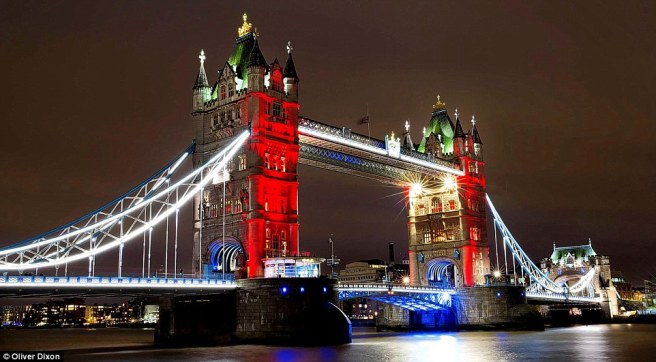 2E7249EA00000578-3318549-Tower_Bridge_is_lit_up_in_the_colours_of_the_French_flag_as_a_vi-a-35
