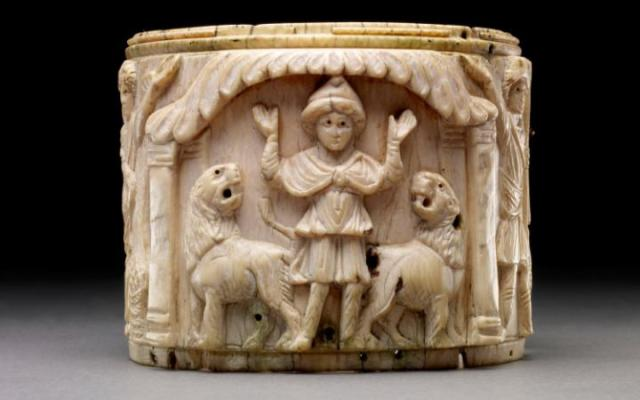 Ivory pyxis box depicting Daniel with arms raised in prayer flanked by two lions, Egypt 5th century AD Credit The Trustees of the British Museum
