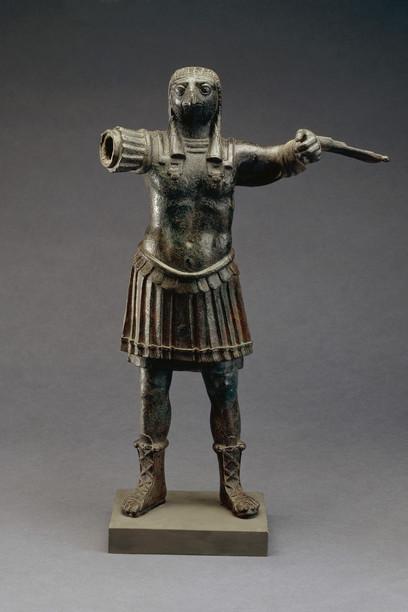 Standing-figure-of-the-Roman-god-Horus-wearing-Roman-military-costume-bronze-Egypt-1st-2nd