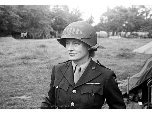 Lee Miller in steel helmet specially designed for using a camera, Normandy, France 1944 by unknown photographer Photographer Unknown © The Penrose Collection, England 2015. All rights reserved