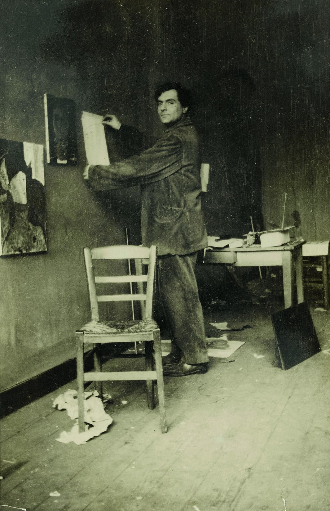 Modigliani in his studio, photographed by Paul Guillaume, c1915. Photograph: © RMN-Grand Palais (Musée de l'Orangerie)