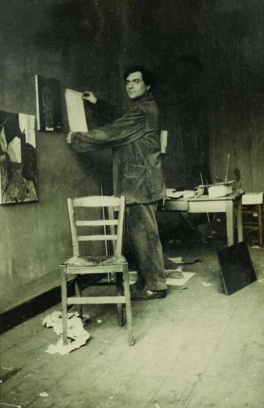 Modigliani in his studio, photographed by Paul Guillaume, c1915. Photograph: © RMN-Grand Palais (Musée de l'Orangerie)