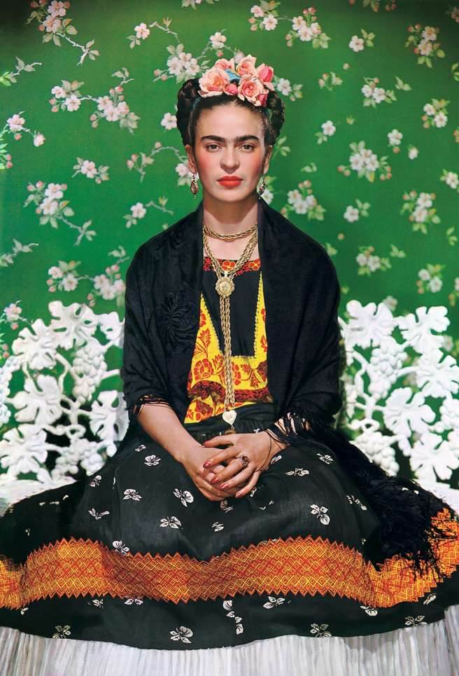 Frida Kahlo On White Bench, a photograph by Nickolas Muray, taken in 1938