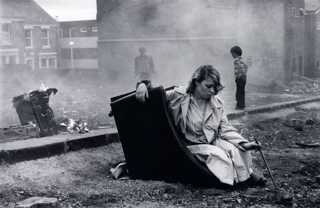 Karen on overturned chair, 1980. Photograph: Tish Murtha/© Ella Murtha, All rights reserved.© Ella Murtha
