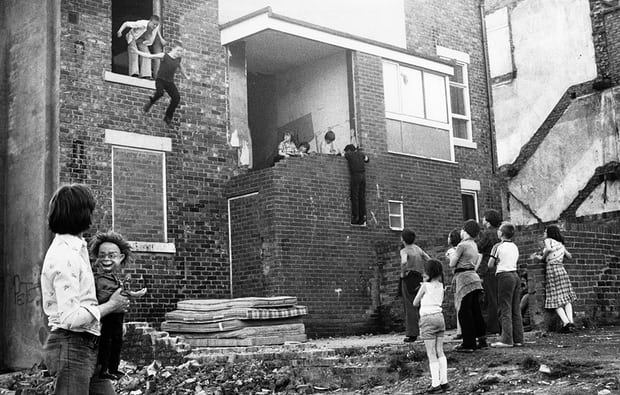 Kids jumping onto Mattresses, 1980 - Photograph: Tish Murtha/© Ella Murtha, All rights reserved.© Ella Murtha
