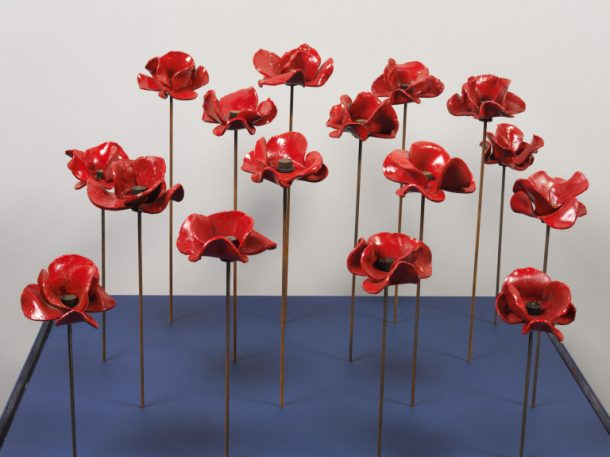 Sixteen ceramic poppies from 'Blood Swept Lands and Seas of Red', Tower of London, 2014. Paul Cummins (artist, original concept); Tom Piper (installation design). ©Victoria and Albert Museum, London/Paul Cummins Ceramics